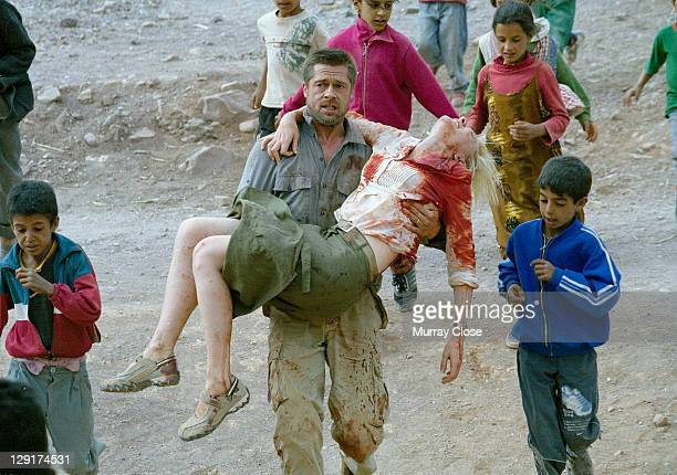 American actor Brad Pitt carrying Australian actress Cate Blanchett for a scene in the film 'Babel' on location in Morocco 2005 The film was directed...