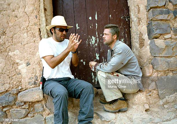 American actor Brad Pitt listens to Mexican director Alejandro Gonzalez Inarritu during the filming of 'Babel' on location in Morocco 2005