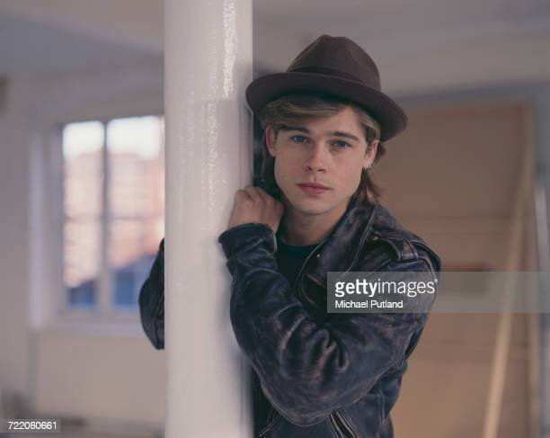 American actor Brad Pitt posed wearing a trilby hat in London in October 1988.