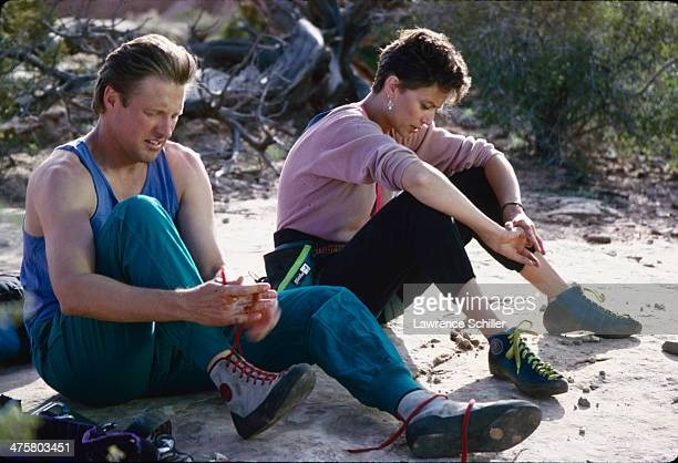 American actor Bruce Boxleitner and British actress Rachel Ward prepare to rock climb in a scene from the tv movie 'Double Jeopardy' Moab Utah 1991
