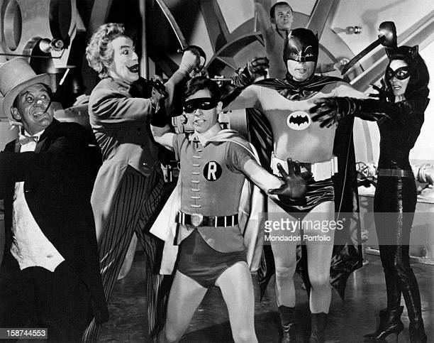American actor Burgess Meredith playing the Penguin, American actor Cesar Romero playing the Joker, American actor Burt Ward playing Robin, American...
