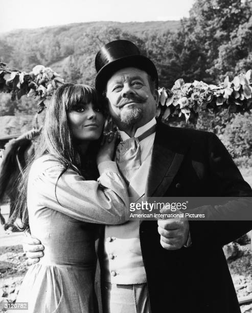 American actor Burl Ives and Israeli actor Daliah Lavi embrace in a still from the film 'Rocket to the Moon' directed by Don Sharp 1967