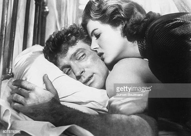 American actor Burt Lancaster and French actress Corinne Calvet on the set of Rope of Sand directed by William Dieterle