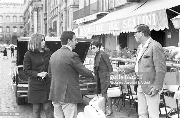 American actor Burt Lancaster and his daughter Joanna unloading luggage from the car in front of the 'Tre scalini' restaurant in piazza Navona Rome...