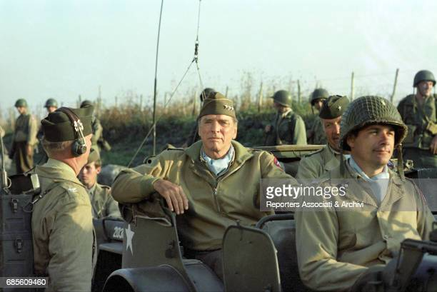 American actor Burt Lancaster as a general on a jeep in The Skin 1981