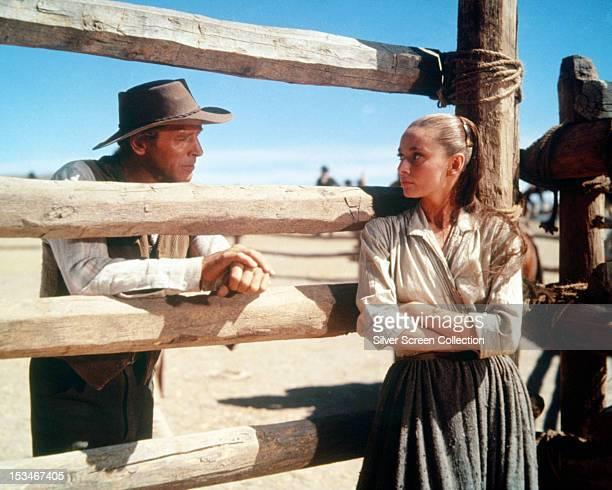 American actor Burt Lancaster as Ben Zachary and Belgianborn actress Audrey Hepburn as Rachel Zachary in 'The Unforgiven' directed by John Huston...