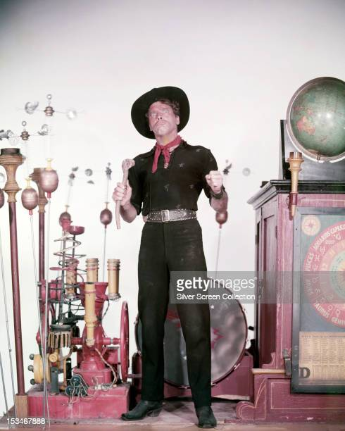 American actor Burt Lancaster as the con man Starbuck in 'The Rainmaker' directed by Joseph Anthony 1956 He is surrounded by bogus inventions for...