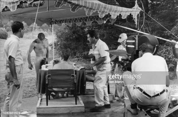 American actor Burt Lancaster on the set of 'The Swimmer' with its authors John Cheever and Cornelia Otis Skinner in Westport CT July 27 1966