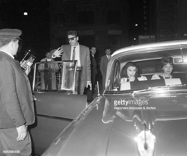 American actor Burt Lancaster trying to throw out the paparazzi on Via Veneto before getting into a car with French actress and model Beatrice...