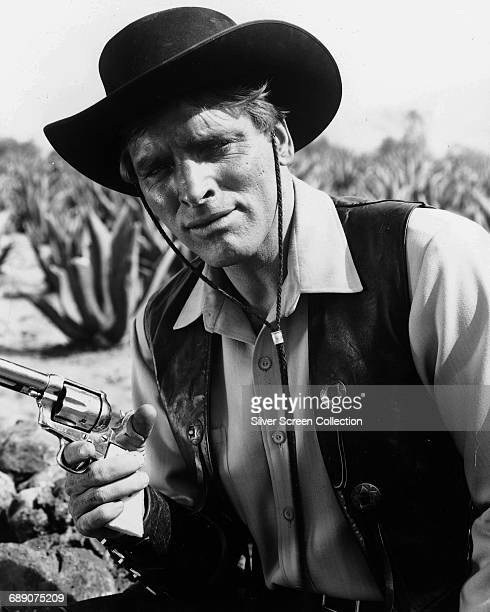 American actor Burt Lancaster with a Colt pistol in a publicity still for the film 'Vera Cruz', 1954.
