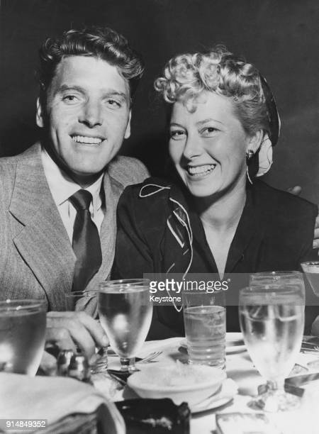 American actor Burt Lancaster with his wife Norma at Romanoff's restaurant in Hollywood California 1958