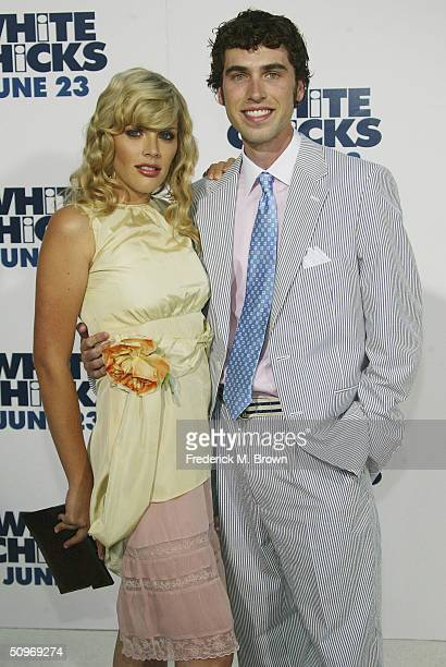 American actor Busy Philipps and her boyfriend Craig Cox attend the film premiere of 'White Chicks' at the Mann Village Theater on June 16 2004 in...