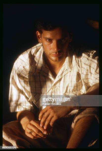 American actor Campbell Scott crouches with a drink in his hand during the shooting of the movie Un The au Sahara or Il Te Nel Deserto originally The...