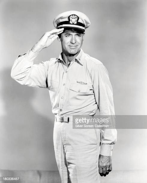 American actor Cary Grant wearing naval uniform and saluting in a promotional portrait for 'Operation Petticoat' directed by Blake Edwards 1959