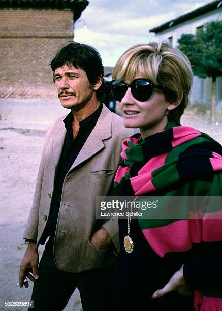 American actor Charles Bronson and British actress Jill Ireland walk together during a break in the production of the film 'Villa Rides' , Andalusia,...