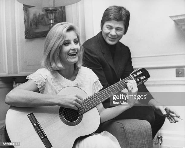 American actor Charles Bronson listens to his wife, actress Jill Ireland , play the guitar in London, 9th January 1969. Bronson is in the UK to star...