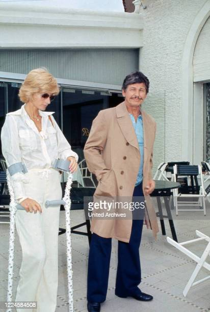 American actor Charles Bronson relaxing wit his wife Jill Ireland France 1970s