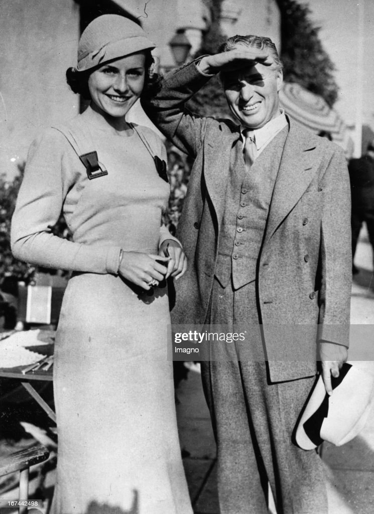 American actor Charles Chaplin and his wife; american actress Paulette Goddard. Los Angeles. 1933. Photograph. (Photo by Imagno/Getty Images) Der amerikanische Schauspieler Charles Chaplin und seine Ehefrau; Schauspielerin Paulette Goddard. Los Angeles. 1933. Photographie.