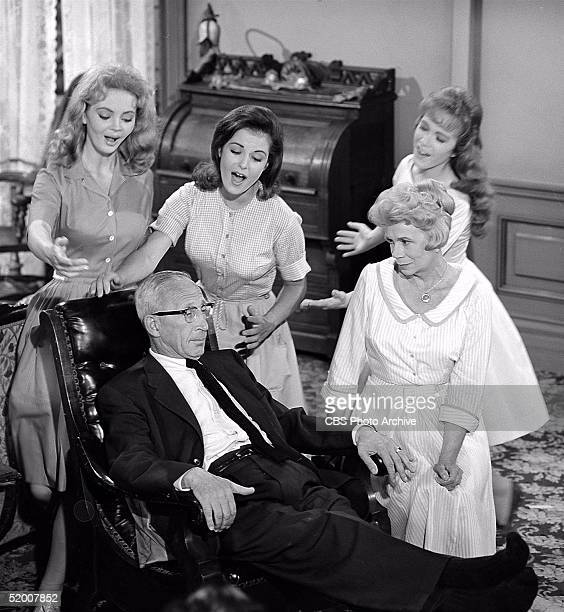 American actor Charles Lane sits in a chair surrounded by American actresses Jeannine Riley Pat Woodell Linda Henning and Bea Benadaret in the...