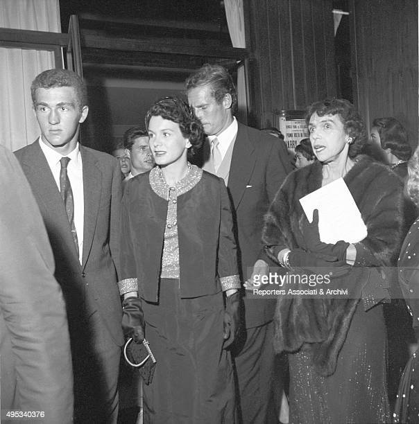 American actor Charlton Heston and his wife and American actress Lydia Clarke getting with some unidentified people the Sistina Theatre for Harry...