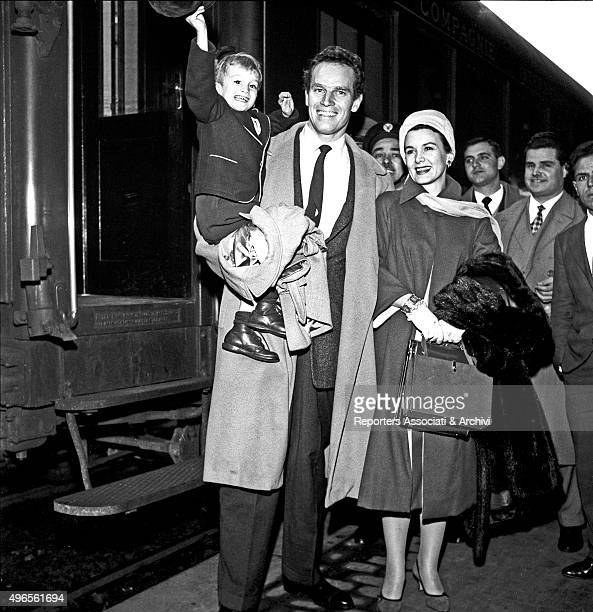 American actor Charlton Heston arriving at Termini railway station with his wife and American actress Lydia Clarke and his son Fraser Clarke Heston...