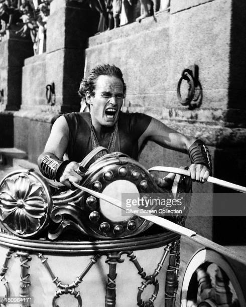 American actor Charlton Heston as Judah BenHur competes in a chariot race in 'Ben Hur' directed by William Wyler 1959