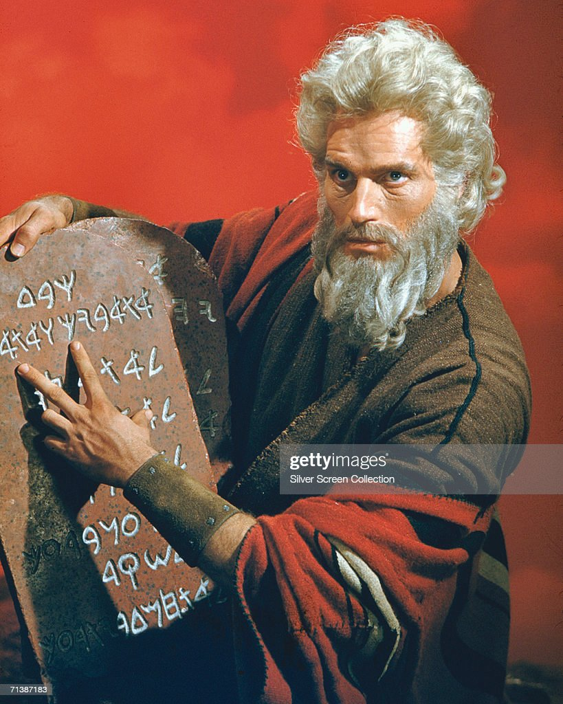 American actor Charlton Heston as Moses with the titular stone tablets in the biblical epic 'The Ten Commandments', directed by Cecil B. DeMille for Paramount, 1956.