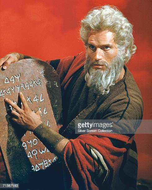 American actor Charlton Heston as Moses with the titular stone tablets in the biblical epic 'The Ten Commandments' directed by Cecil B DeMille for...