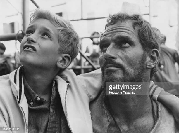 American actor Charlton Heston as painter Michelangelo on the set of the Carol Reed film 'The Agony and the Ecstasy' in Todi Italy 1964 With him is...