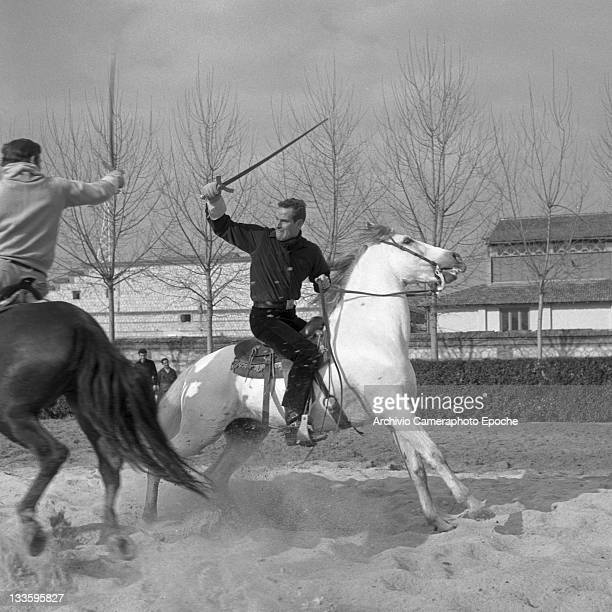 American actor Charlton Heston during a sword duel riding a horse for the 'El Cid' shooting Lido Venice 1960s