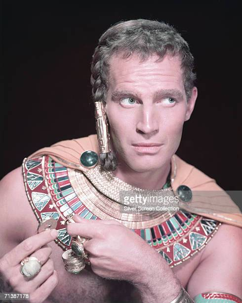 American actor Charlton Heston in ancient Egyptian dress as Moses in the biblical epic 'The Ten Commandments', directed by Cecil B. DeMille for...