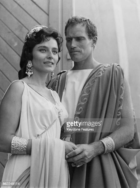 American actor Charlton Heston in costume with actress Marina Berti , his co-star in the film 'Ben-Hur', circa 1958.