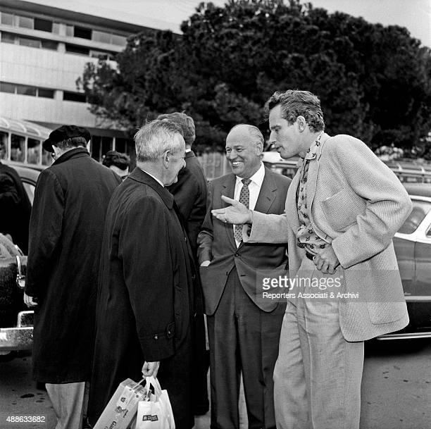 American actor Charlton Heston just landed at Ciampino airport to shoot the film 'Ben Hur' talking with American director William Wyler who will...