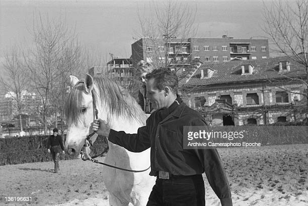 American actor Charlton Heston lunging a horse in a paddock Lido Venice 1961