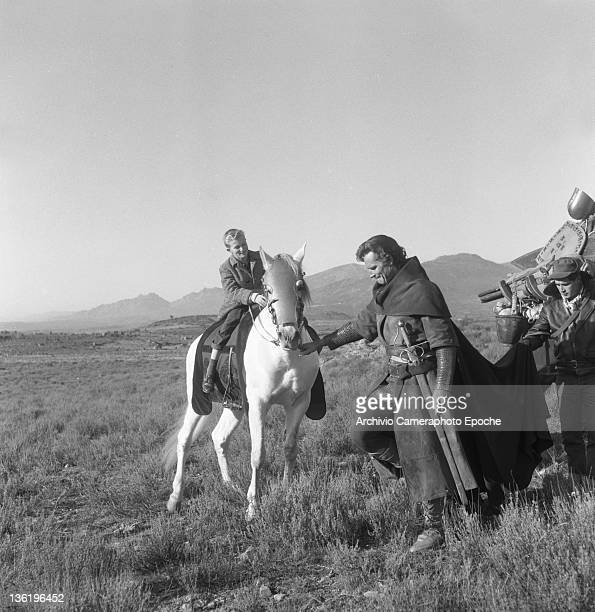 American actor Charlton Heston on 'El Cid' set with his son Fraser Spain 1961