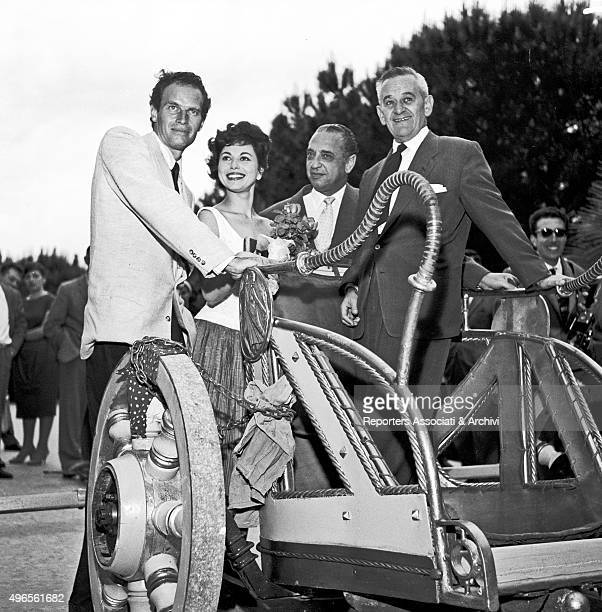 American actor Charlton Heston posing on a chariot with his wife and American actress Lydia Clarke American producer Sam Zimbalist and American...