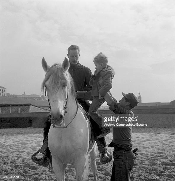 American actor Charlton Heston riding a horse with his son Fraser Lido Venice 1961