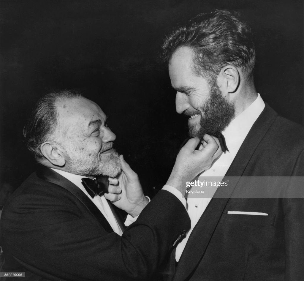 American actor Charlton Heston (1923 - 2008, right) tugs the beard of fellow actor Edward G. Robinson at the annual awards dinner of the Directors' Guild at the Beverly Hilton Hotel in Beverly Hills, California, 11th February 1963. Both beards were grown for screen roles.