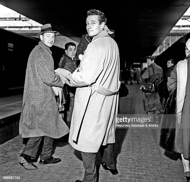 American actor Charlton Heston walking on the platform at Termini railway station holding his son Fraser Clarke Heston Rome April 1958