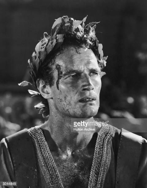 American actor Charlton Heston wears a laurel wreath on his head in a still from director William Wyler's film 'BenHur'