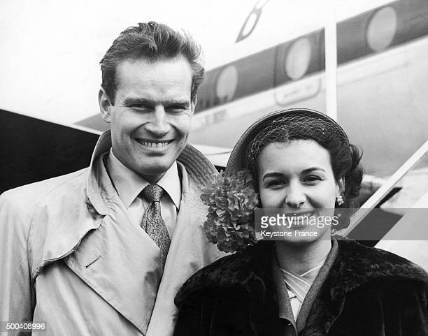 American actor Charlton Heston with his wife Lydia Clarke at the airport on March 17 1962 in London United Kingdom