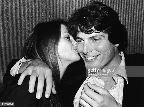 American actor Christoper Reeve best known for his role as Superman is kissed by his long term girlfriend Gae Exton 19th February 1980