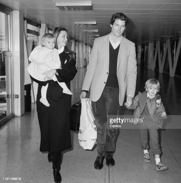 American actor Christopher Reeve with his partner Gae Exton and their children Matthew Reeve and Alexandra Reeve Givens at Heathrow Airport London UK...