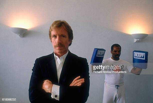 American actor Chuck Norris stands near a martial arts trainer in Cannes Norris is in town to attend the Cannes Film Festival