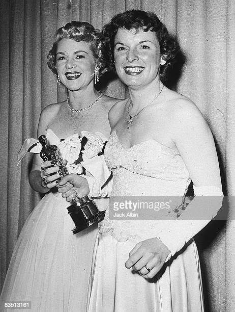 American actor Claire Trevor presents the Best Supporting Actress award to American actor Mercedes McCambridge at the Academy Awards Hollywood...