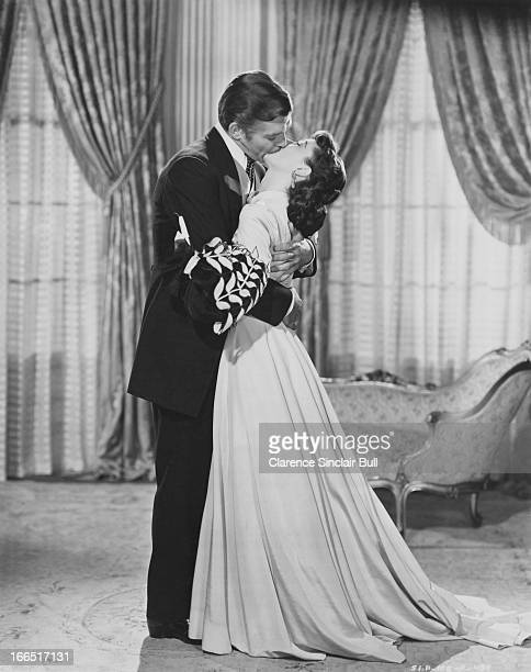American actor Clark Gable , as Rhett Butler, and English actress Vivien Leigh as Scarlett O'Hara in a promotional portrait for 'Gone with the Wind...