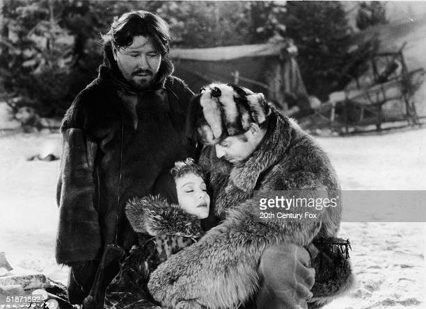 American actor Clark Gable embraces the reclined form of American actress Loretta Young as American actor Jack Oakie looks on in this still from the...