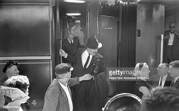 American actor Clark Gable getting out of the train at Termini railway station for the presentation of the film It Started in Naples On his left his...