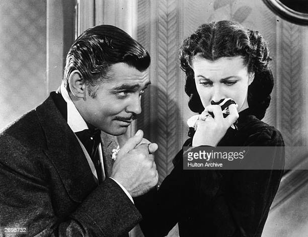 American actor Clark Gable in his role as Rhett Butler kissing the hand of a tearful Scarlett O'Hara played by Vivien Leigh in 'Gone With The Wind'