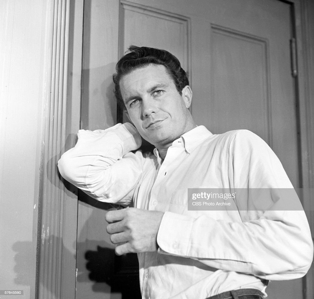 American actor Cliff Robertson (as Joe Clay) stands with his arm braced against a closed door in a still from episode 'The Days of Wine and Roses' of the CBS Television series 'Playhouse 90,' September 2, 1958. The episode originally aired on October 2, 1958.
